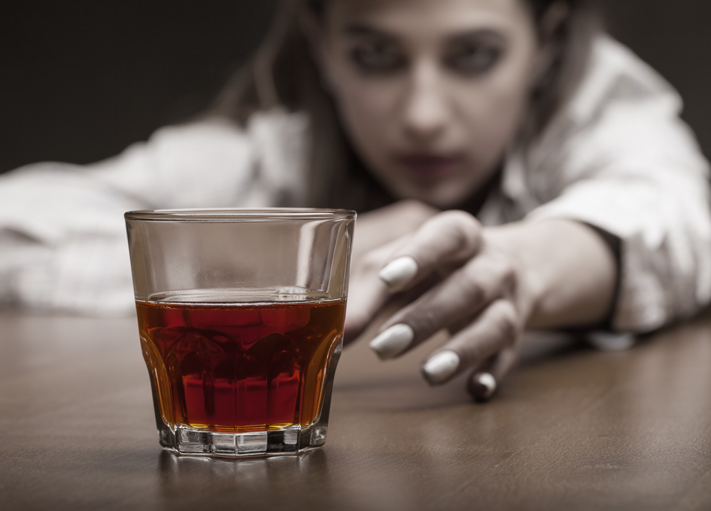 reaching for a drink Stages of addiction denial